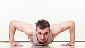 Sports man making pushups,. Care about health and body Royalty Free Stock Images