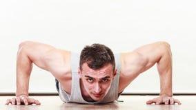Sports man making pushups, Royalty Free Stock Photos