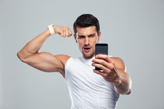 Sports man making selfie photo on smartphone Royalty Free Stock Images