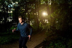 Sports man running at night. Stock Image