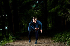 Sports man running at night. Stock Images