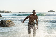 Sports man running in water Royalty Free Stock Images