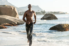 Sports man running in water Stock Photos