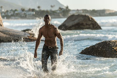Sports man running in water Stock Photo