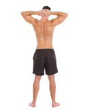 Sports man showing muscular body. Rear view Royalty Free Stock Photo