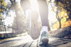Sports man snickers on the move. Sporty young man walking trough park Royalty Free Stock Image