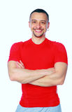 Sports man standing with arms folded Royalty Free Stock Image