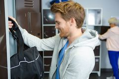 Sports man standing in locker room at gym. Sports men standing in the locker room at the gym Royalty Free Stock Images