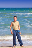 The sports man  standing  near  the sea Stock Photo