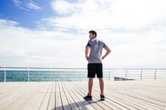 Sports man standing near sea outdoors Royalty Free Stock Photo