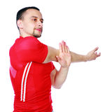 Sports man stretching the arms. Over a white background Stock Photo