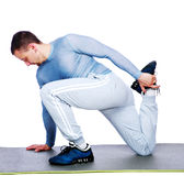 Sports man stretching Royalty Free Stock Photos