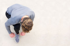 Sports man tying shoelace before run Royalty Free Stock Photography