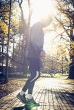 Sports man using jump rope to exercise. On the move Stock Photography