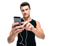 Sports man using smartphone with headphones Stock Image