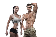 Sports man and woman posing in studio stock image