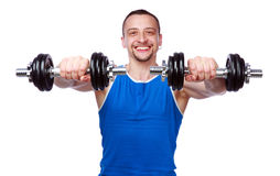 Sports man working out with dumbbells. Smiling sports man working out with dumbbells on white background Royalty Free Stock Photography