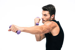 Sports man working out with small dumbbells Royalty Free Stock Photo