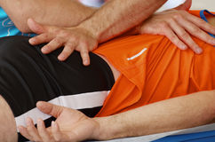 Sports massage therapists work. Sports massage therapists help athletes after a marathon race royalty free stock images