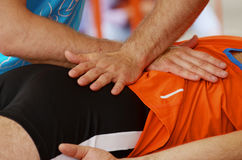 Sports massage therapists work. Royalty Free Stock Images