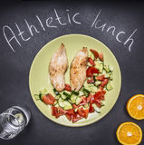 Sports meal, protein fat and carbohydrates, two turkey breast, glass water and oranges top view Stock Photos