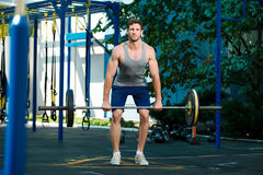 Sports model exercising outside as part of healthy dumbbells. Male sports model exercising outside as part of healthy lifestyle Stock Photography