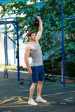 Sports model exercising outside as part of healthy dumbbells Stock Photo