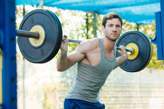 Sports model exercising outside as part of healthy dumbbells Royalty Free Stock Images