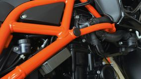 Sports motorbike frame. Close-up. Camera moves along the sports bike frame. The bike in details stock video footage