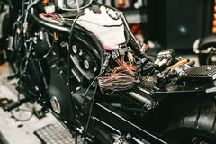 The sports motorcycle dismantled - repair of electronics. Bike at the service station Royalty Free Stock Photos
