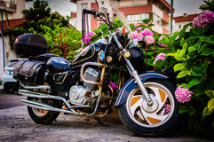 Touring Motorcycle In Street Side. Elegant black vintage motorcycle parked in a street at bright summer day. Photo taken at: 2016-06-28 royalty free stock photo