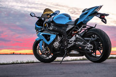 Sports motorcycle on the shore at sunset. Sports motorcycle on the shore at summer sunset Royalty Free Stock Photo