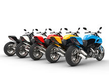 Sports motorcycles in a row - back view Stock Photo