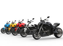 Sports motorcycles in a row - various colors Royalty Free Stock Images