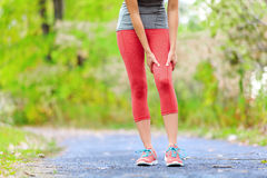 Sports muscle injury of female runner thigh Royalty Free Stock Image