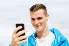 Sports and music. man getting ready for jogging Royalty Free Stock Photo