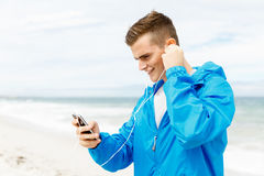 Sports and music. man getting ready for jogging Stock Image