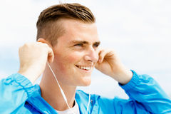 Sports and music. man getting ready for jogging Royalty Free Stock Image
