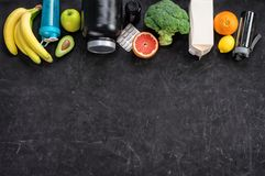 Sports nutrition on a black background. Top view. Motivation. Close up Royalty Free Stock Photography