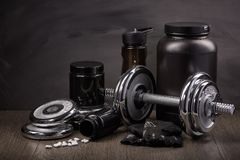 Sports nutrition and fitness equipment. Royalty Free Stock Photography
