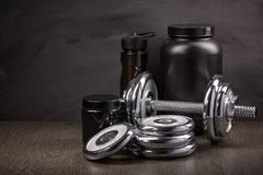 Sports nutrition and fitness equipment. Royalty Free Stock Image