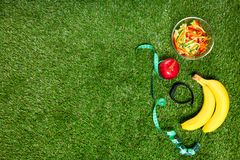 Sports nutrition of fruits and vegetables, concept on a background of green grass. Sports nutrition of fruits and vegetables, concept on a background stock photography