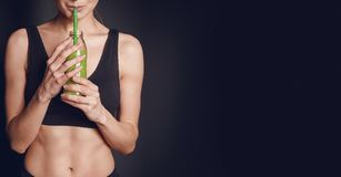 Sports nutrition. the girl drinks smoothies.  royalty free stock image
