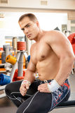 Sports nutrition. Muscular handsome man relaxing after traiining in a gym. Sports, bodybuilding. Healthy lifestyle Royalty Free Stock Images