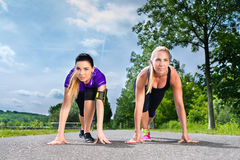 Sports outdoor - young women doing fitness in park stock photography
