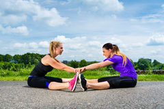 Sports outdoor - young women doing fitness in park royalty free stock images