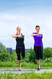 Sports outdoor - young women doing fitness in park Stock Photo
