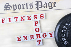 Sports page. With a crossword puzzle combined from words fitness, sports and energy Royalty Free Stock Photo