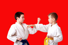 Sports paired exercises karate athletes perform in a kimono Royalty Free Stock Images