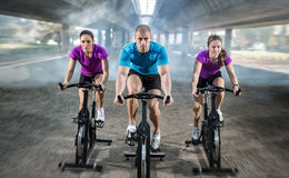 Sports people training bike riding Stock Images